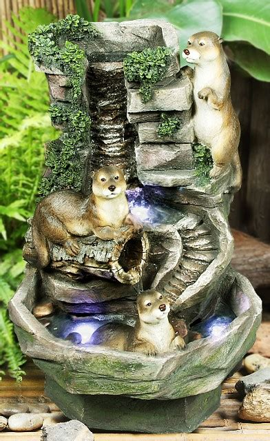 playful otters water feature  led lights