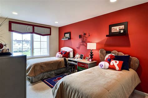 red accent wall baseball themed kids bedroom with a striking red accent
