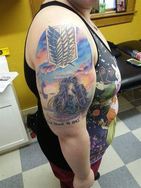 sword art online tattoo wings of freedom and sword tattoos