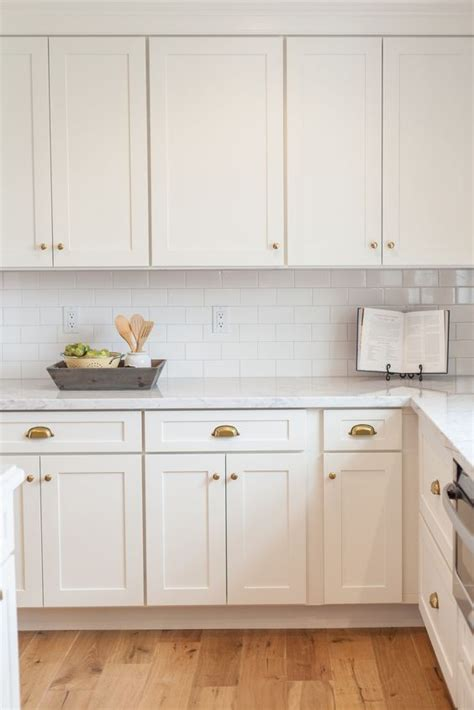 knobs for white kitchen cabinets white shaker cabinetry with brass cups and knobs by