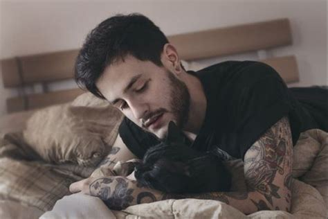 cat tattoo on guy s stomach tattooed guy snuggling with cat adorable pinterest