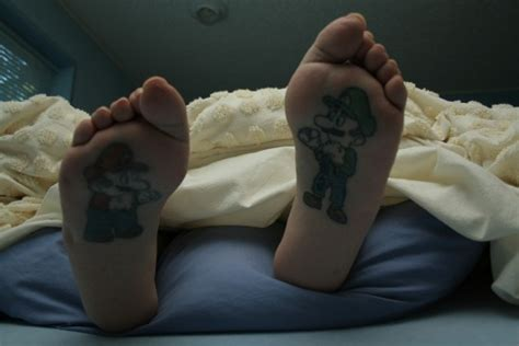 tattoos on the bottom of your feet dude gets mario and luigi tattooed on soles of gearfuse
