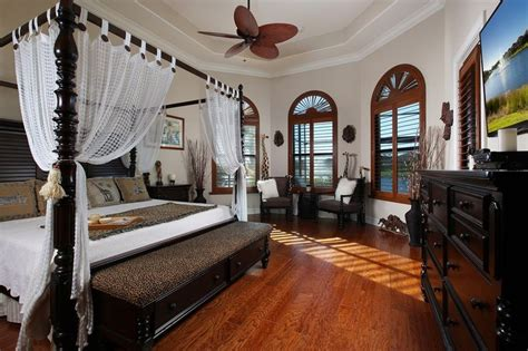 tropical living room with high ceiling ceiling fan in tropical master bedroom with paint1 high ceiling crown
