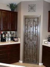 Iron Pantry Door by Pantry Doors On Pantry Doors Wrought Iron