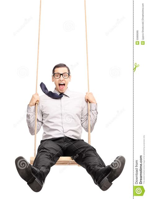 swing guys joyful swinging fast on a swing stock photo