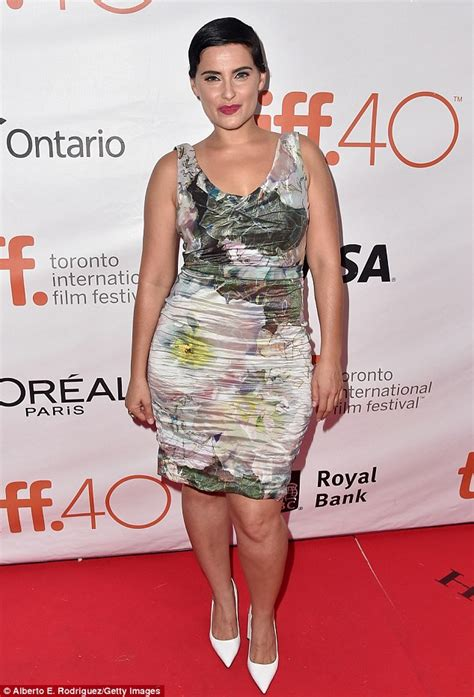 by her latest artwork it appears that nellys thicky thick girl nelly furtado reveals curvier figure in pencil dress at