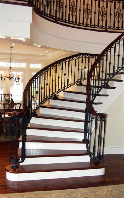 wood staircases love this grand staircase especially the iron work