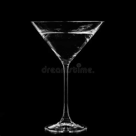 martini glass background martini in a cocktail glass on black background stock