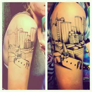 This is my tattoo of the oklahoma city skyline it s a photo i took