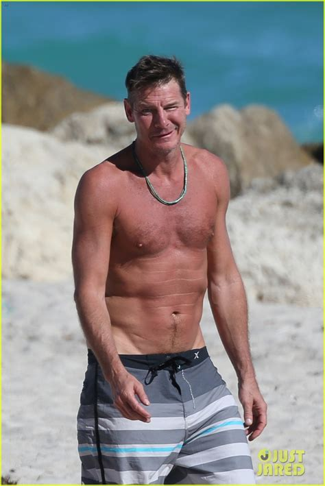 ty pennington extreme makeover s ty pennington goes shirtless puts