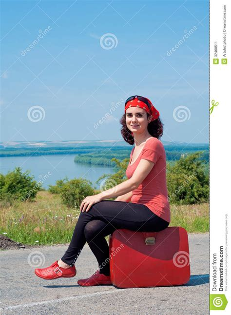gorgeous red suitcases young woman sitting on a red suitcase stock image image