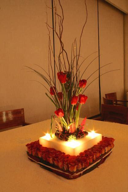 adornos de mesa para bodas con velas como hacer un centro de mesa con velas
