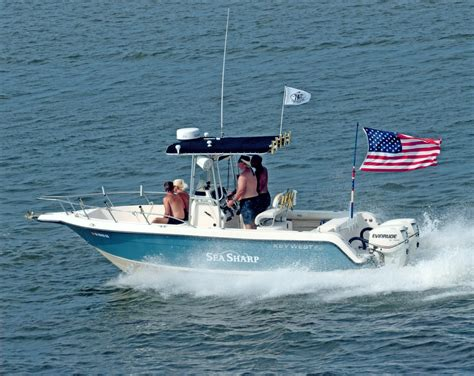american fan boat flag waving fun loving tht crowd the hull truth