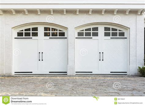 White Garage Doors by Garage Doors To A White Home Stock Photo