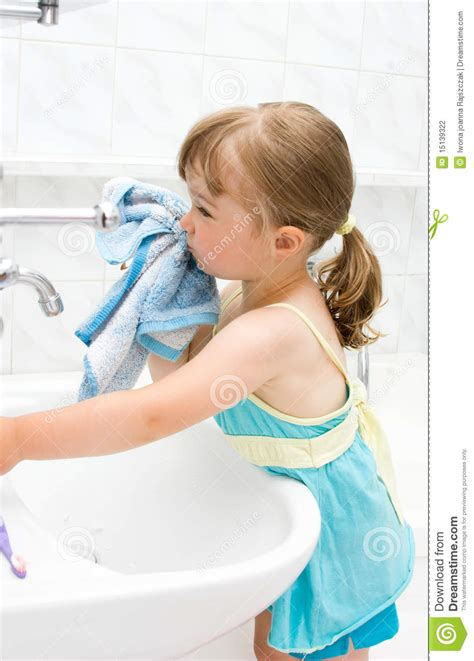 a girl using the bathroom little girl in bathroom stock photography image 15139322