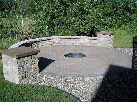 permeable paver patio with firepit and seat wall explore
