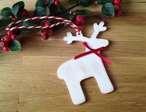 wooden christmas decoration handmade reindeer by lottieandlois