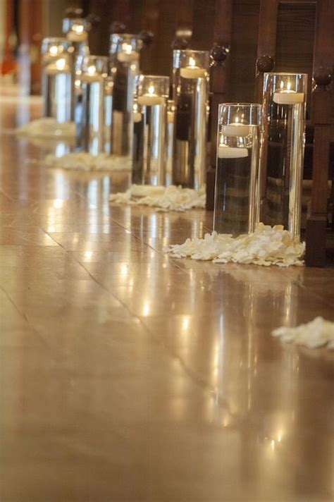 Wedding Aisle Candle Holders by Floating Candles In Glasses And Petals Aisle And Ceremony