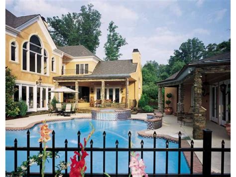 Farmhouse Wrap Around Porch house plans with swimming pools home plans with pools at