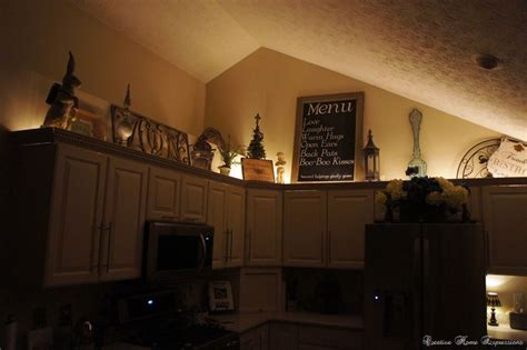 how to decorate on top of cabinets with vaulted ceiling top of cabinet decor ideas