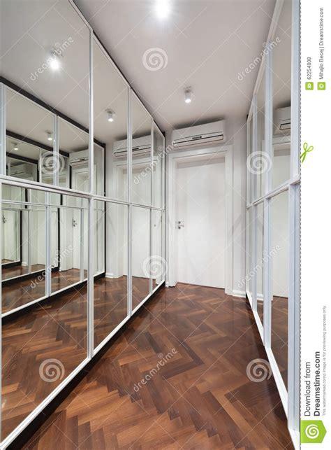 modern corridor interior with mirror wardrobe doors stock