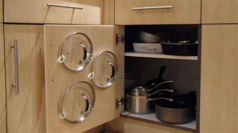 Kitchen Hacks Lifehacker by Use Adhesive Hooks To Organize Your Pot Lids And Save
