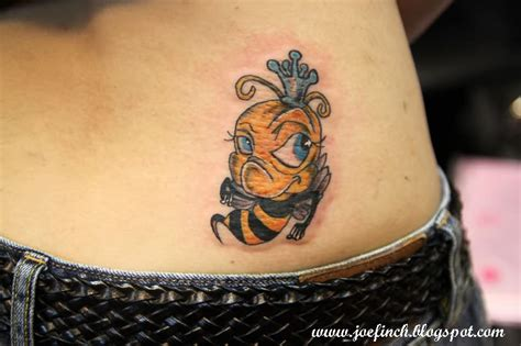 cute lower back tattoos bumblebee on lower back