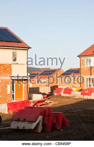 new build social housing with solar panels and a green