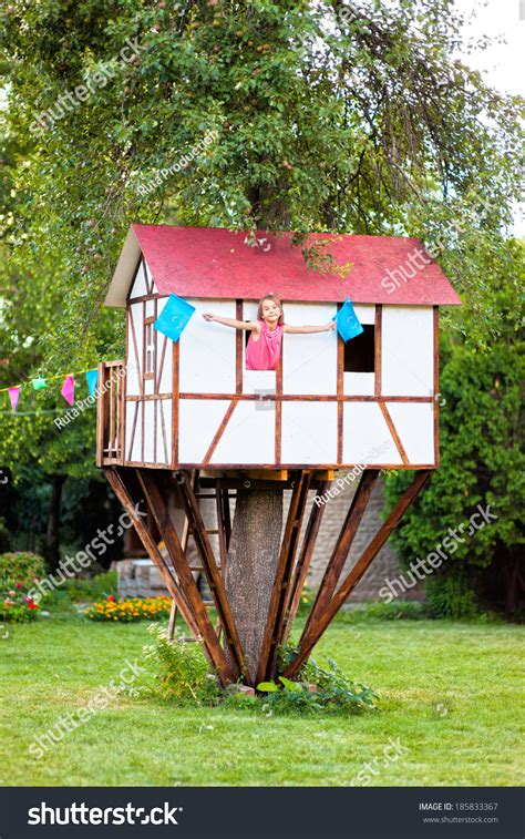small house for kids cute small tree house for kids on backyard girl inside stock photo 185833367