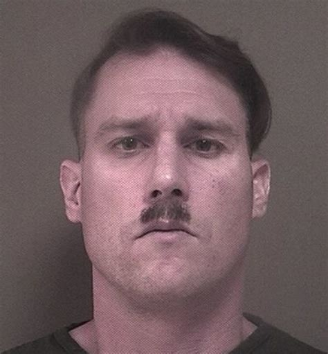 convicted felon with mustache and possible white