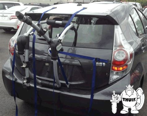 2009 hhr chevy blac on hatchback roof 2012 toyota prius c thule hatch mounted bicycle rack fits