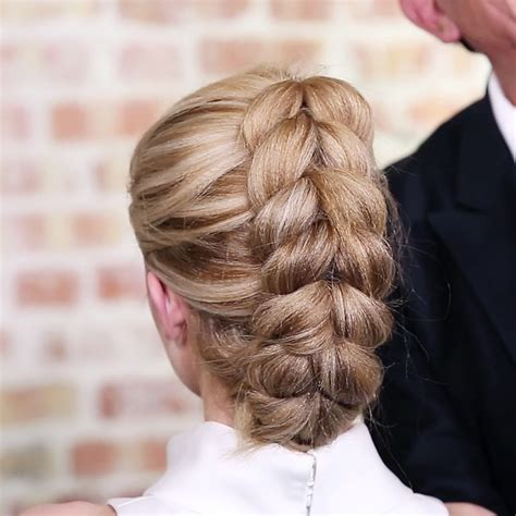 hairstyle using rubberbainds and folding hair through to create braid french pull through braid ponytail