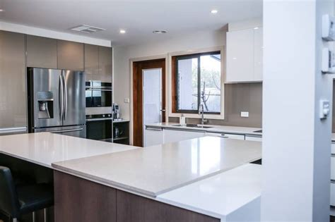 Shitake and osprey caesarstone bench tops in designer kitchen for one of my clients
