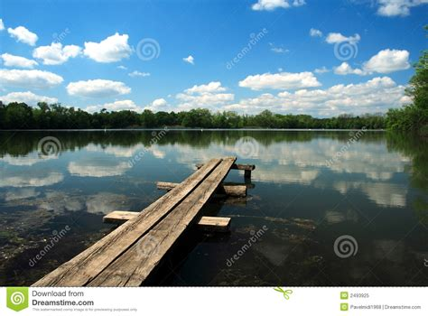 bench over bench over pond royalty free stock photo image 2493925