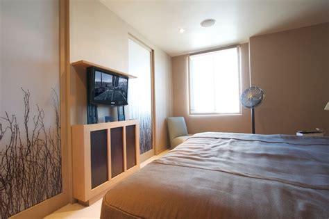 hidden tv in bedroom youtube hidden tv inside custom lift cabinet asian bedroom