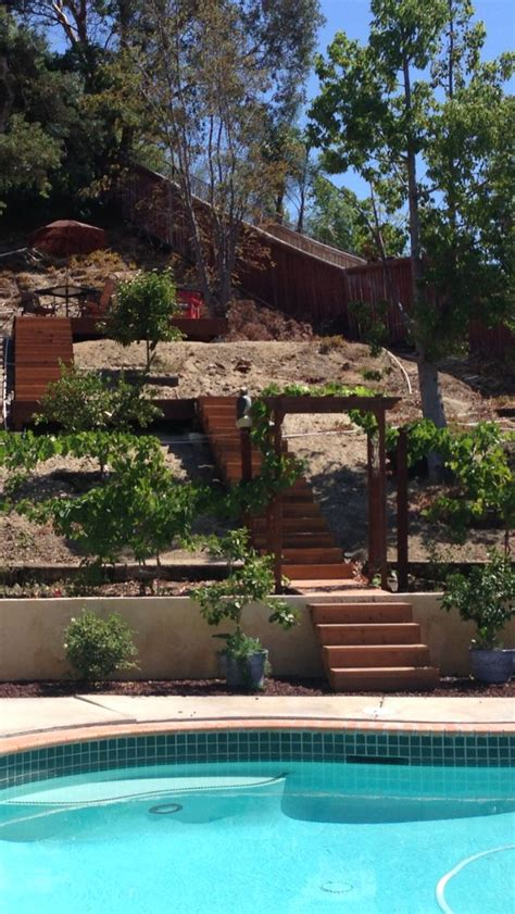 Backyard stairs and deck on hill.   landscaping: back   Pinterest
