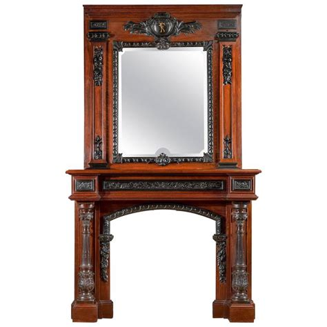 rosewood and antique fireplace mantel in the