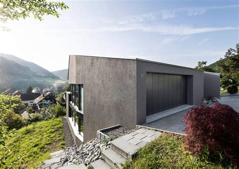 single family house single family house built on a steep slope that leads to