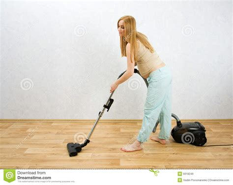 how to vacuum carpet pregnant woman cleaning floor with vacuum cleaner stock