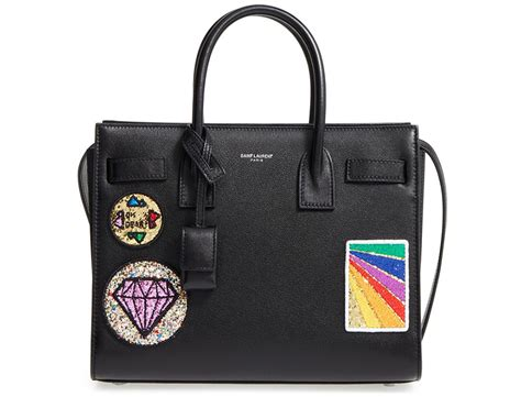The Big Bag Trend Just Got Bigger bags with patch embellishments might just be the next big