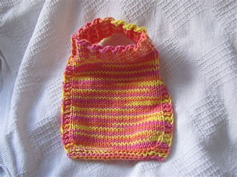 knit stay free knitting pattern for a baby bib that stays put