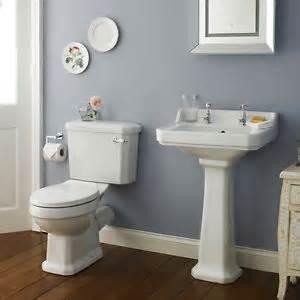 bathroom wc toilet cistern basin sink and pedestal