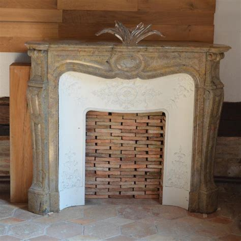 antique pink marble corner fireplace