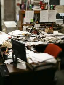 cluttered desk meaning desks in the office can actually lead employees to