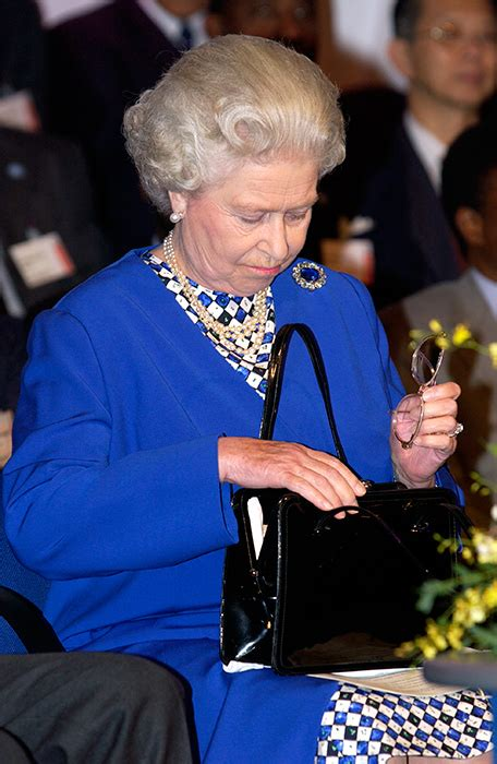 queen elizabeth purse what s inside the queen s handbag and why is it so