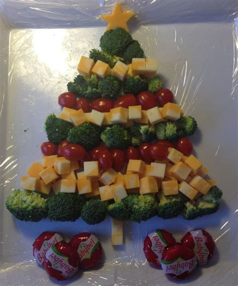 christmas tree cheese platter with broccoli and cherry
