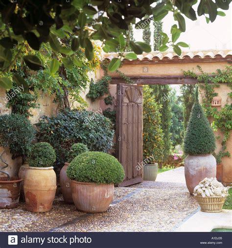 mediterranean villa entrance  terracotta pots stock