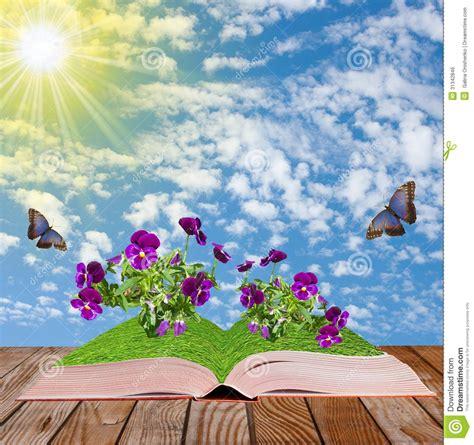 libro i fiori libro aperto su una superficie di legno con i fiori e le