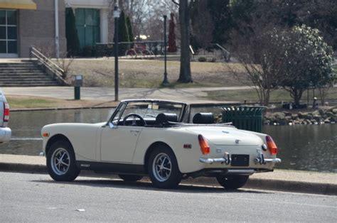 seller  classic cars  mg midget whiteblack