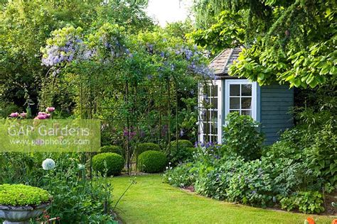 contemporary cottage garden gap gardens summerhouse and pergola in small